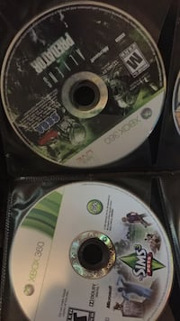 two The Sims 3 Pets and Aliens vs Predator Xbox 360 game discs