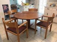 "TABLE & 4 CHAIRS Solid teak expandable with two 36"" inserts to make x-large table. Inserts approx 36"" each. Original price $1499. In excellent condition Maple Ridge"