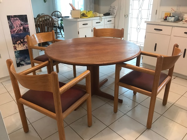 "TABLE & 4 CHAIRS Solid teak expandable with two 36"" inserts to make x-large table. Inserts approx 36"" each. Original price $1499. In excellent condition"