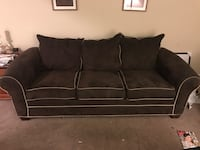 Dark brown sofa that is very deep, approximately 29 inches. So comfortable!