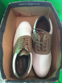 Pair of white-and-brown golf shoes with box