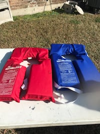 two blue and red safety vests