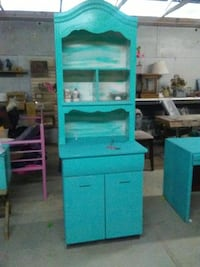 blue wooden cabinet with drawer