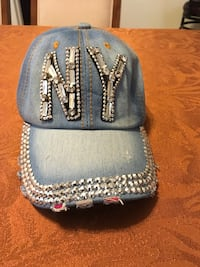 Blue and white baseball cap 399 mi