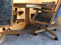 brown adjustable  wooden table with 4 chairs 24 mi