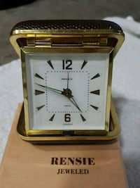square gold-colored analog watch with link bracele