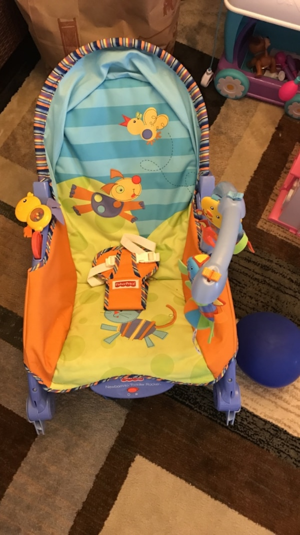 baby's yellow and blue Fisher-Price bouncer seat