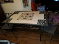 One of a kind  wrought iron tile top table and chairs  refinished