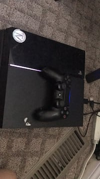 black Sony PS4 game console with controller Penticton, V2A 7V8