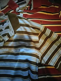two red and blue Tommy hilfiger polo shirts