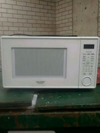 white General Electric microwave oven Arlington, 22202