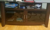 "TV STAND (GLASS). IT HOLDS UP TO 50"" INCHES TV.."