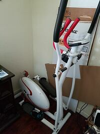 white and red elliptical trainer