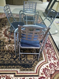 Glass dining table with folding chairs  Beltsville, 20705