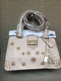 Brown and light pink leather tote bag from guess  Clarington
