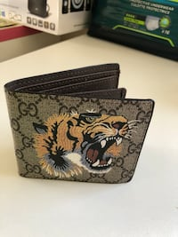 black and brown floral leather wallet Vancouver, V6P 2X3