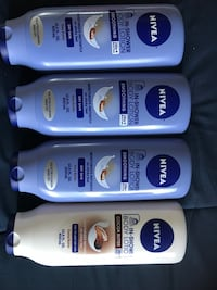 3 blue Nivea body lotion ; 1 white Nivea body lotion