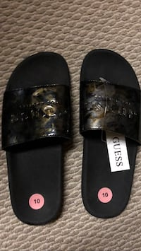 pair of black leather slide sandals Edmonton, T5Y 0Y6