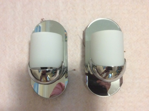 two oval stainless steel candle holders