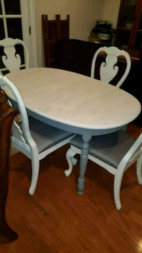 round white wooden table with four chairs dining set Sanford, 32771