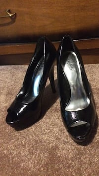 Pair of black patent leather open-toe pumps