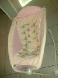 baby's pink and white bouncer San Angelo, 76904