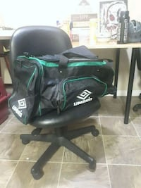 green and black leather padded rolling armchair Edmonton, T5A 3R4