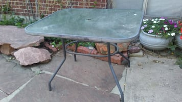 """Glass top garden patio table 40x33"""" will deliver"""