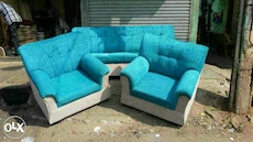 teal and white micro-suede couches