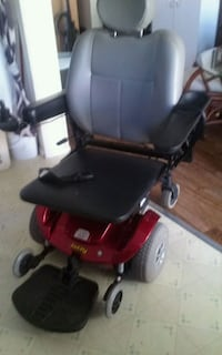 red and black motorized wheelchair Clifton, 81520