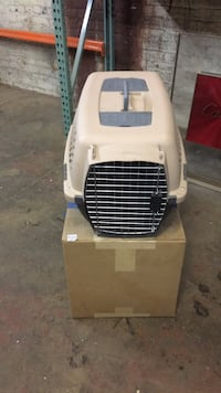 Beige and black pet carrier New York