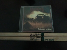 Bloodless disc album. With signed drum sticks.
