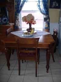 Antique 1927 Gibbard walnut dining table with chairs  Kitchener, N2M 1L5