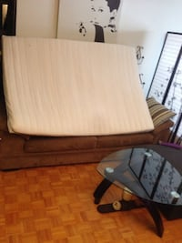 Brown wooden bed frame with white mattress Toronto