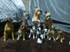 Several assorted color ceramic Boxer Dog figurines