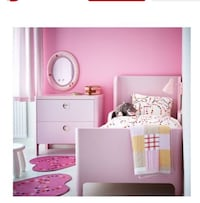 white wooden bed frame with pink bed sheet Olney, 20832
