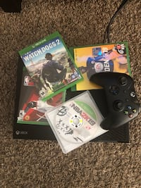 Xbox One console with controller and game cases 1027 mi