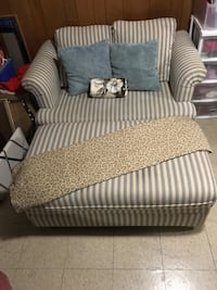 Blue grey and off white chair and a half. From Levin. Pulls out to twin bed (mattress) included. 57 w 36 d x 30 h with matching storage ottoman. Good condition.48w 24 d 19 h Willowick, 44095