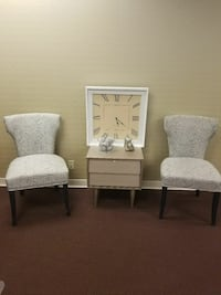two padded grey fabric chairs