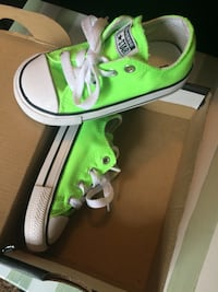 toddler's pair of green Converse shoes with box