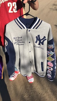 gray and blue New York Yankees jacket
