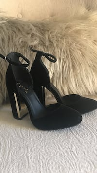 Pair of black close top ankle strap sandals Los Angeles, 90066