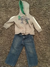 gray and green hoodie with blue denim pants