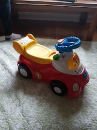 toddler's red and yellow ride on toy car