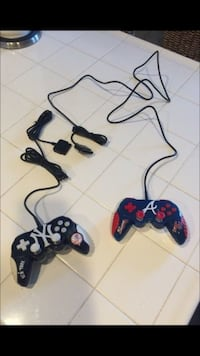 2 brand new PS2 collectible controllers