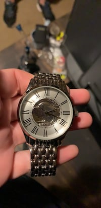round silver analog watch with silver link bracelet Old River-Winfree, 77535