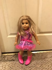 doll with blond hair wearing pink dress and boots