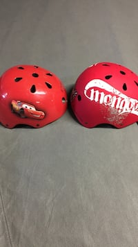 Two red and white skateboard helmets Montréal, H8Y 2P3