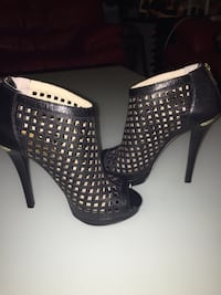 Michael KORS caged booties.