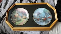 Thomas kinkaid collector plates in glass case